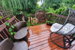 Wooden veranda with a view of the garden in the rain